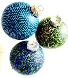 Christmas ornaments with hand-painted dots.