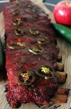These Apple Jalapeno Smoked ribs are on a whole nother level. Sweet and Spicy come together in a magical union. We looooooove us some ribs. Something about the messy hands, messy face, and full acknowledgement that the flavor of what you Traeger Recipes, Rib Recipes, Roast Recipes, Grilling Recipes, Sauce Recipes, Venison Recipes, Cooker Recipes, Slow Cooking, Cooking Tips