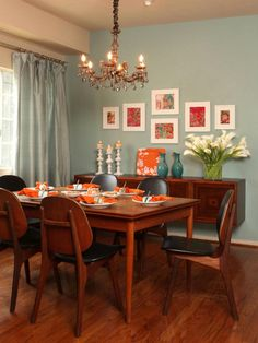 Cool blue walls and drapes create a soothing backdrop when contrasted with bright orange accents. Framed watercolors, in a riot of color and pattern, add extra punch to this space. Design by Christopher J. Grubb.