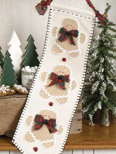 Use this free sewing pattern to make a fun, festive wall hanging with appliqued gingerbread men. Skill Level: Easy