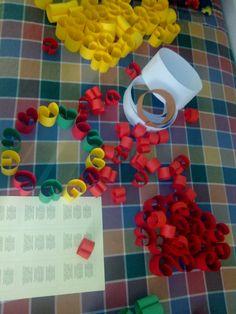 120 piccole mele di cartoncino colorato per realizzare una ghirlanda autunnale colorata e armoniosa accompagnata da una simpatica filastrocca