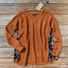 Gorgeous rust tones adorn this cozy thermal sweater. A soft thermal inspired knit base pairs with plaid side inset details, long cozy sleeves, a v-neck, and a soft slouchy fit. Perfect paired with jea