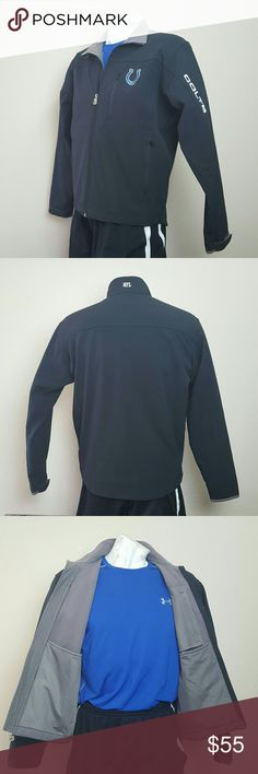 """NFL Apparel COLTS Soft-Shell All-Weather Jacket! Excellent used condition. NFL Apparel solid black all weather full-zip softshell jacket. Lightweight, durable wind/rain resistant breathable fabric; grey fleece inner lining. Embroidered royal blue & white Indianapolis Colts team logo on upper left chest & white """"COLTS"""" on upper left sleeve. Two zippered front pockets, a tech pocket, & adjustable velcro wrist straps. 100% polyester soft shell & 100% polyester fleece lining. Licensed NFL…"""