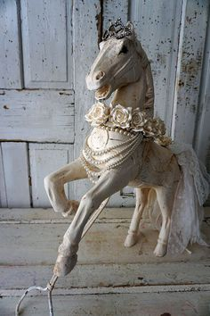 White carved wood horse statue painted distressed French Nordic all white sculpture handmade shabby lace tail w/ roses home decor anita spero design measures: 29 tall by 25 long and 6 wide I have been reclaiming wooden horse for years now. I do love working with many styles. But by far this is my favorite. When ever I find these I am always delighted in the way the horse is posed. This horse came out so amazing. I painted it in a homemade soft white. I used 2 types of homemade paint to ...