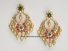 Gorgeous chand bali earrings with a perfect balance of polki diamonds, rubies and pearl drops in 22 karat gold. polki diamonds chand bali earrings