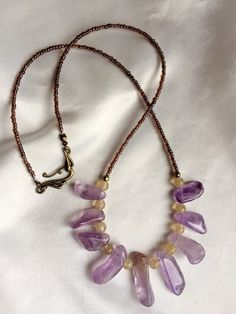 Raw crystal amethyst, citrine, & ametrine necklace. Unique, rustic and earthy, purple and yellow gemstone jewelry. February birthstone by WildThingsAdornments