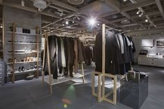 We created a series of bespoke raw timber hanging rails and acrylic concrete-effect plinths, to show off the collection that embodies CIFF's vision of the modern Scandinavian male.