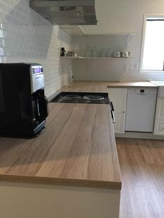 Our Client Chose A Laminate Countertop For Her IKEA Kitchen. Why? Because  Quartz Is