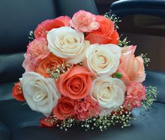 rose bridal bouquet in coral, pinks, and ivory!
