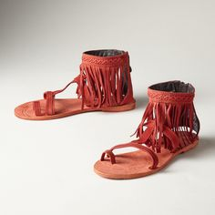 PRAIRIE GRASS SANDALS--Artful, leather fringe sways with each step in these handcrafted sandals by Liberty Black. Leather. Imported. Whole and half sizes 6 to 10, 11.