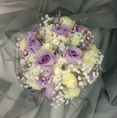 Lavender and white bridal bouquet with hydrangeas, roses, limonium and babies breath by Nancy at Belton hyvee.