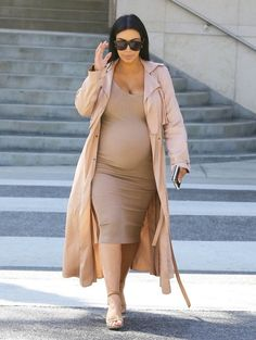Kim Kardashian Photos Photos - Pregnant reality star Kim Kardashian heads to lunch at La Scala in Beverly Hills, California on October 22, 2015. Kim, who celebrated her 35th birthday yesterday at San Ysidro Ranch with her husband Kanye West, showed off her huge baby bump in a tight beige dress. - Kim Kardashian Lunches in Beverly Hills