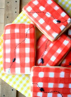 Gingham picnic biscuits! Love the 'insect' detail.