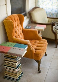 orange tufted wingback - I've been desperately seeking one precisely like this for ages.