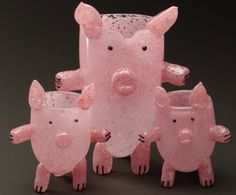 Family of glass pig cups.
