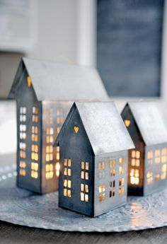 Rustic tin houses with lights as centerpiece or standalone Christmas decoration #europe @ http://lightingworldbay.com #lighting