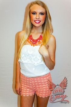 Southern Lace Crop Top in White  - Sweet and girly in a lovely white crotchet lace cropped tube top. An exposed and sheer floral lace ruffle wraps around the top of the bodice giving a cutesy edge. Made unique by the flirty cropped length, this piece is soft and feminine for casual spring and summer days that need a little feminine boost. Great paired with high waist shorts and cowgirl boots for a Southern girl's lacey look!  - available online at http://www.envyboutiqu