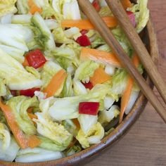 asian pickled cabbage  1 head napa cabbage, 1  large carrot, 2-4 red chili peppers, 1 cup rice wine vinegar, 1/2 cup sugar, slice of ginger, 1 T salt