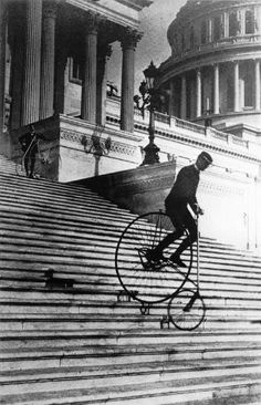 Will Robertson of the Washington Bicycle Club riding an American Star Bicycle down the steps of the United States Capitol in 1885