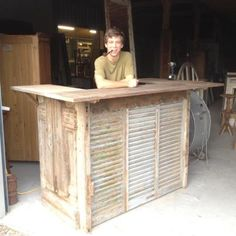 Reception desk or bar designed from antique door, shutters, cypress...