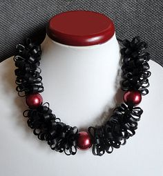 Short black rubber jewelry with some red beads by AnnesSierraad, €15.00