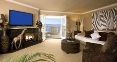 Safari Themed Room For Adults | Oceanside Marina Suites: Exotic Themes - DiscoverSD.com Safari Living Rooms, Safari Room, Living Room Themes, Living Room Colors, Bedroom Themes, Safari Theme, Bedroom Ideas, Bedrooms, African Living Rooms