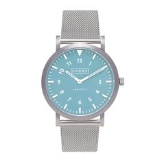 Brushed Silver Light Blue Face Inspired by the look of venerable explorer watches, our watches are designed to mirror vintage timepieces with modern design features and are fully equipped to both stand out and weather the demands of a modern lifestyle.Buying for someone else? Remove the guesswork with our Gift Cards.Outer Casing: Silver Plated 316L Stainless SteelMovement: Miyota Quartz MovementWater Proof: 100 metersGlass: Crystal SapphireDial Diameter: 39mmCrown Size: 4mm (Wave…