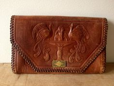 Vintage embossed hand tooled leather clutch by 360vintage on Etsy, $65.00