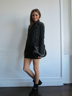 wearing a jacket by DVF with a skirt by Bird by Juicy Couture. shoes are KORS Michael Kors, and bag is by Devi Kroell