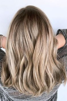 """Los Angeles coloristChrissie Plisky blended two highlighting techniques — balayage and babylights — for bright, beautiful dimension, while adding a rooty look """"so she can wear it longer without having to get it touched up as often."""""""