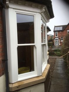Roseview Windows #Ultimate #Rose vertical sliding sash windows in a white woodgrain foil, authentic run through horns and stone cills. Installed in Gedling, Nottingham. For a free quotation visit our website http://www.thenottinghamwindowcompany.co.uk, pop into our west Bridgford showroom or call us on 01158 660066. #roseview #ultimate #rose #Gedling #SashShots #nottingham