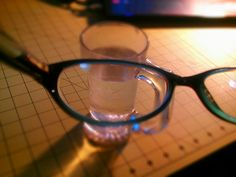 """241/366: Lensception - New lenses in my glasses; wondered what my phone's camera would see through them. So here we have a camera lens, my glasses lens, and a glass of water as a third """"lens"""". May have to try more of these with my DSLR.    Physics note: Distortion on the view through the glasses is more noticeable since they're further away from the camera lens than they are from my eyes when I wear them. I did that on purpose.    Android Camera 360"""