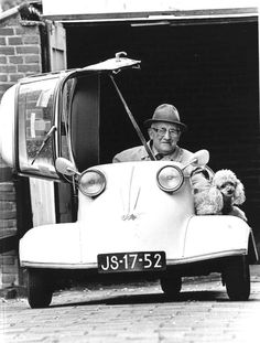 5.19.1983 - An old timer and his friends.... Now 86 years old Mr. J. Outjes has a drivers license for 64 years and takes daily rides with his 22 years old Messerschmidt on the roads in the Randstad Holland. Sylvia is always with him. The dog has accompanied Outjes on this rides for 14 years. #amsterdam #historic #sites