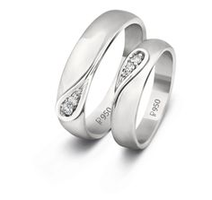 """""""The yin-yang arrangement of diamonds in these Love Bands personifies a union of two distinct opposites, who are filling each other's weaknesses with one another's strength. (Men's band- Pt wt:9.43gms, diamond wt:0.06cts)(Woman's band- Pt wt:6.45gms, Diamond wt:0.04cts) """""""