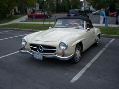 My Dad had one of these - same color, too. 1955 Mercedes 190SL Convertible.