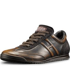 HOGAN REBEL - Black calf leather sneakers enriched with ochre shades.