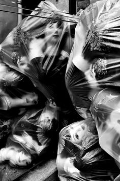 Dolls | via Graphik Addict | vintage mannequins | doll heads wrapped in plastic | spooky | freaky | this photo will give me nightmares | scary | eyed that follow you around the room