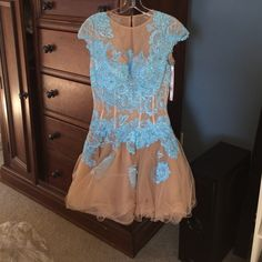 I'll never wear it again Super pretty on, mesh and corset built in. Easy to move in and I got a lot of complements on Homecoming when I wore it. Sherri Hill Dresses Mini