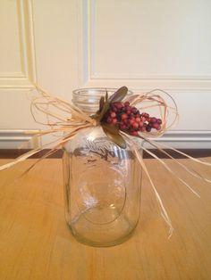 mason jar with raffia and simple flower
