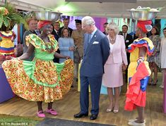 Impressed: Charles and Camilla admired the bright outfits