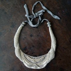Lovely beaded silver grey necklace by Hoss.
