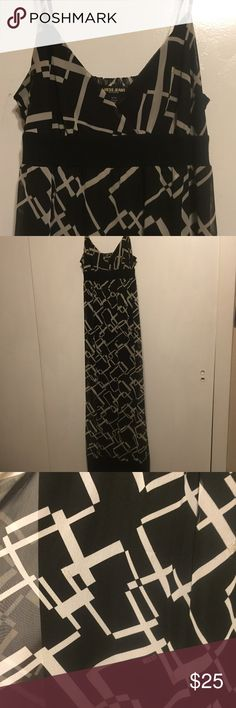 Guess Maxi Dress- Super Comfy! This dress is the perfect match of cute and comfy! Black with a tan and silver geometric pattern, the dress has spaghetti straps and an elastic panel in the back. The lining underneath is solid black. Perfect for the farmers market or dinner out! GUESS Dresses Maxi