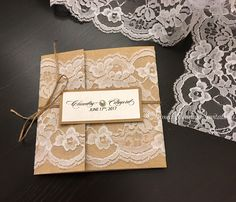 Vintage lace and Kraft gatefold wrapped with twine. This rustic invitation is perfect for an outdoor wedding  See more at www.boxedweddinginvitations.com   #Kraftweddinginvitation