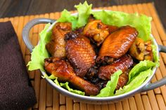 Honeyed Chicken wings--crockpot.    Ingredients:    3 pounds chicken wings  Salt and pepper, to taste  1 1/2 cups honey  1/2 cup soy sauce  2 Tablespoons vegetable oil  2 Tablespoons ketchup  1/2 garlic clove, minced