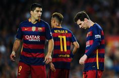 Lionel Messi (R) of FC Barcelona looks on dejected past his team mates Neymar and Luis Suarez during the La Liga match between FC Barcelona and Valencia CF at Camp Nou on April 17, 2016 in Barcelona