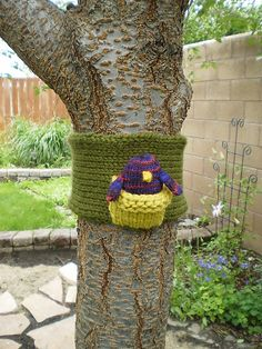 """Tree cozy and nest.... a great way to """"yarn bomb"""".... put a bird in it!"""