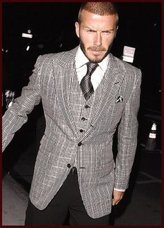 Well done, Becks. Well done, indeed. Love the gray jacket and vest, the tie, the shirt and the black pants. It's all mud and sweat and dirt by day, but clean as a whistle when he steps into the night!