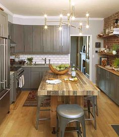 Prep, serve, and entertain at an island that fits stools underneath, offering seating for a gathering of friends. The homeowners added iron legs to bring this butcher block piece to the right height.