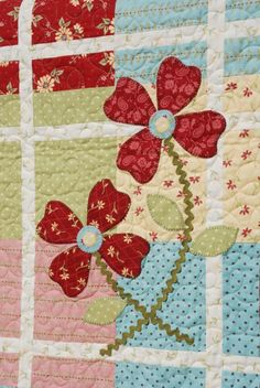 Beautiful detail applique on quilt...country girls always need another quilt!
