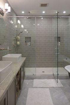 Contemporary Master Bathroom with Lynzie 2-light chrome vanity fixture, oval mirror, Flat panel cabinets, can lights, Shower